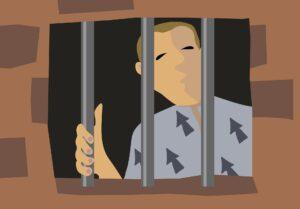 personne derrière les barreaux